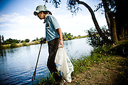 A volunteer picks up trash during Coastal Cleanup Day on Hogback Island, September 19, 2009.