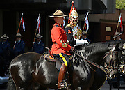 "© Licensed to London News Pictures. 22/05/2012. London, UK Sgt Major Bill Stewart (L) from the Royal Canadian Mounted Police talks with Staff Corporal ""Gene"" Hackman of the Blues and Royals. Canadian Mounties rehearse with members of The Household Cavalry today 22 May 2012 to Guard Her Majesty the Queen at Horse Guards Parade. They will guard on Wednesday 23 May and will be the first non-British force to guard the Queen ever. Photo credit : Stephen Simpson/LNP"