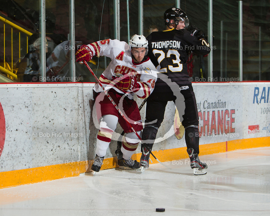 22 September 2012:  Josh Hansen (15) of the Chiefs, Blake Thompson (23) of the Grizzlies  during a game between the Chilliwack Chiefs and the Victoria Grizzlies at  Prospera Centre, Chilliwack, BC.    Final Score: Chilliwack 2  Victoria 4   ****(Photo by Bob Frid - All Rights Reserved 2012): mobile: 778-834-2455 : email: bob.frid@shaw.ca ****