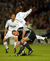 Photo: Scott Heavey, Digitalsport<br /> NORWAY ONLY<br /> <br /> Olimpique Marseille v Newcastle United. UEFA Cup Semi Final, Second Leg. 06/05/2004.<br /> Alan Shearer comes under pressure from Abdoulaye Meite