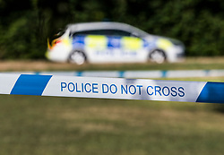 © Licensed to London News Pictures. 04/07/2018. Amesbury, UK.  A police car and is parked on the village green at Raleigh Crescent in Amesbury where it is thought  Dawn Sturgess, 44, and her partner Charlie Rowley, 45, may have visited for a family fun day before they were taken ill on Saturday 30th June 2018. Police have confirmed that the couple have been in contact with Novichok nerve agent. Former Russian spy Sergei Skripal and his daughter Yulia were poisoned with Novichok nerve agent in nearby Salisbury in March 2018. Photo credit: Peter Macdiarmid/LNP