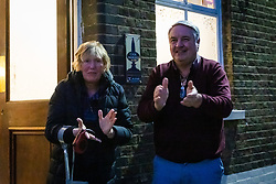 © Licensed to London News Pictures. 02/04/2020. London, UK. A couple applauds outside a pub this evening in Wapping, east London during the 'clap for the NHS' and 'clap for carers' campaigns held in support of the NHS, as the spread of the coronavirus continues. Photo credit: Vickie Flores/LNP