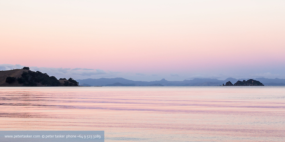 Looking toward Coromandel Peninsula while at anchor in Opopo Bay, Waiheke Island.  Waiti Bay and headland on the left and Tarahiki Island on the right. Beautifully complex evening light.