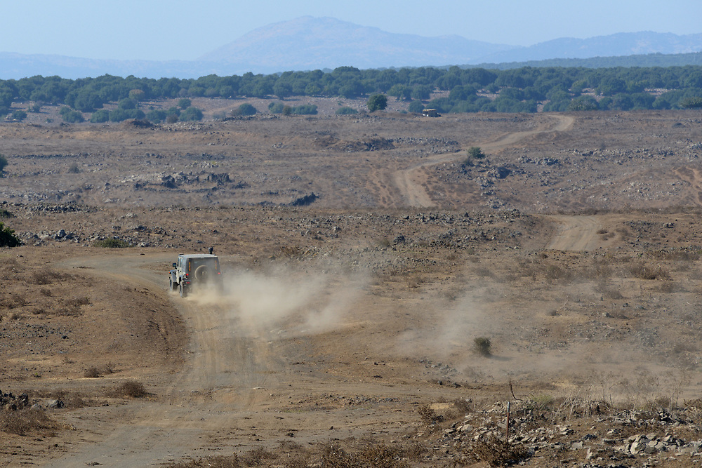 GOLAN HEIGHTS, UNSPECIFIED - AUGUST 30: An Israeli Army vehicle is seen as it patrols on August 30, 2013 near the border with Syria, in the Israeli-annexed Golan Heights. Tensions is rising in Israel amid talks of a military intervention In Syria. Photo by Gili Yaari