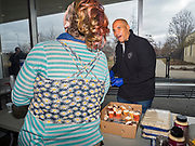 27 NOVEMBER 2019 - DES MOINES, IOWA: US Senator CORY BOOKER (D-NJ) talks to a client at Central Iowa Shelter and Services in Des Moines. Sen Booker helped plate up and serve lunch at the shelter. The shelter has about 180 beds and is full almost every night. In January and February, more than 250 people per night come to the shelter, which sets out overflow bedding. Senator Booker is running to be the Democratic nominee for the US Presidency in 2020. Iowa hosts the first selection event of the presidential election season. The Iowa caucuses are February 3, 2020.      PHOTO BY JACK KURTZ