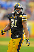 Iowa Hawkeyes linebacker Anthony Hitchens (31) during the LSU Tigers 21-14 win over the Hawkeyes in the 2014 Outback Bowl at Raymond James Stadium on January 1, 2014 in Tampa, Florida.                                  <br /> <br /> ©2014 Scott A. Miller