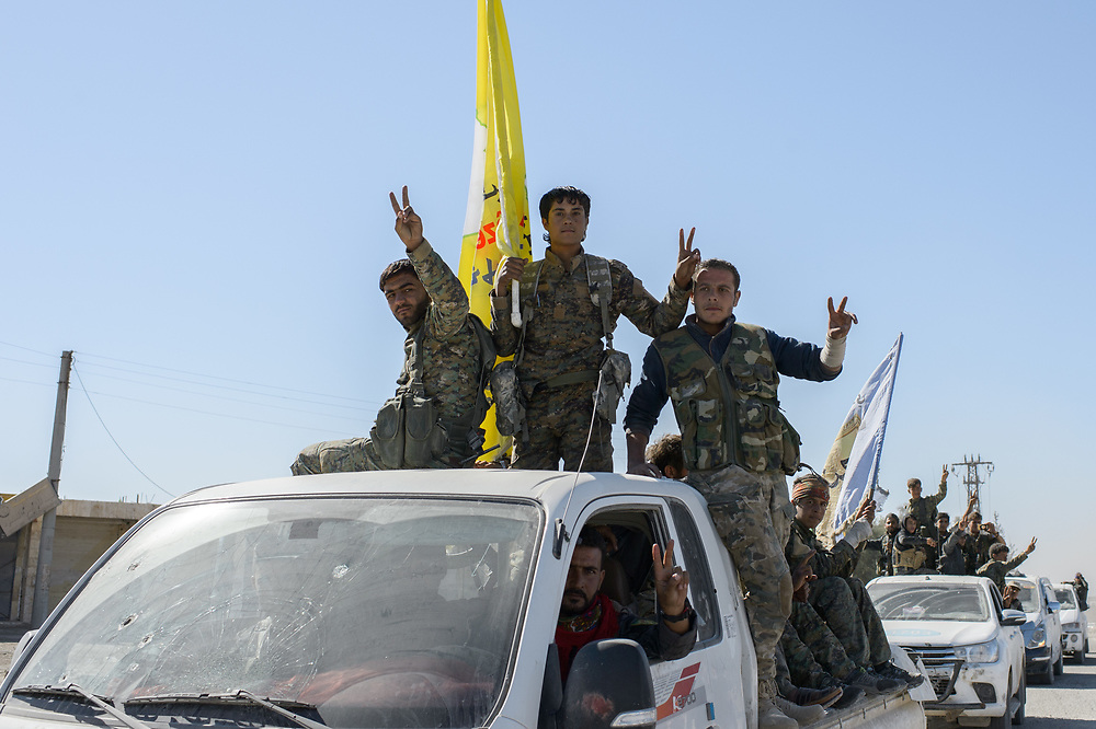 SDF fighters drive through the city and celebrate victory over ISIS in Raqqa, Syria, October 18, 2017