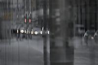 Reflections of Bay St. traffic, Toronto.