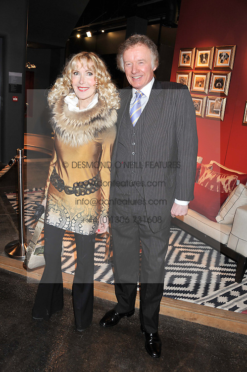 RICHARD & BASIA BRIGGS at a party to celebrate the publication of Folly de Grandeur: Romance and Revival in an English Country House by Nicky Haslam held at Oka, 155-167 Fulham Road, London on 21st March 2013.