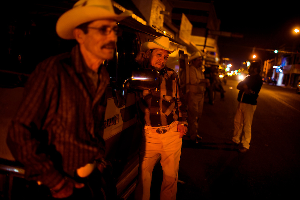 "Musicians that sing ""corridos"", or ballads, wait for customers to hire them on a street in downtown Culiacan.  These musicians are famous for writing narco-ballads, detailing the lives of drug dealers.  The narcos hire the musicians, paying as much as $1000 to write and record a ballad about their lives.  In recent years, scores of the musicians have been killed in what is believed to be drug related murders."