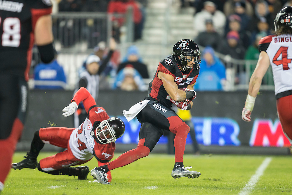 Khalil Paden of the Ottawa Redblacks avoids a tackle from Joe Burnett of the Calgary Stampeders during the 3rd quarter of the 104th Grey Cup Final in Toronto Ontario, Sunday,  November 27, 2016.  (CFL PHOTO - Geoff Robins)