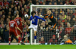 LIVERPOOL, ENGLAND - Tuesday, March 13, 2012: Liverpool's goalkeeper Jose Reina, Andy Carroll and Jordan Henderson in action against Everton's Marouane Fellaini during the Premiership match at Anfield. (Pic by David Rawcliffe/Propaganda)