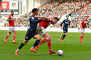Tyler Roberts (11) of Leeds United battles for possession with Adam Webster (4) of Bristol City during the EFL Sky Bet Championship match between Bristol City and Leeds United at Ashton Gate, Bristol, England on 9 March 2019.