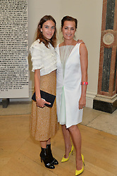Left to right, ALEXA CHUNG and YASMIN LE BON at the annual Royal Academy of Art Summer Party held at Burlington House, Piccadilly, London on 4th June 2014.