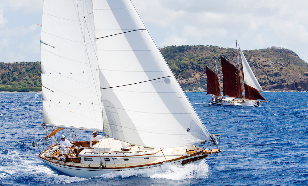 Two unidentified Yachts speed away from the start of the 2008 Antigua Classic Yacht Regatta . This race is one of the worlds most prestigious traditional yacht races. It takes place annually off the coast of Antigua in the British West Indies.