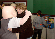 Max (left) from Max & Erma's gets a hug from a fan before the Dayton Gems take on the Flint Generals at Hara Arena, Sunday, November 22, 2009.