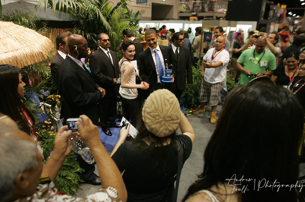 Andrew Foulk/ Zuma Press.July 24, 2009, San Diego, California, USA. Comic Con. A group of  Comic Con attendees take photos of an impersonator playing the role of President Barack Obama, during day two of the 40th annual San Diego International Comic Con.