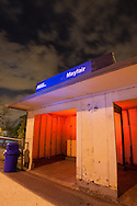 The small Metra shelter at the Mayfair stop on Chicago's Northwest side is lit up with red and blue gelled strobes on a cloudy and stormy spring night.