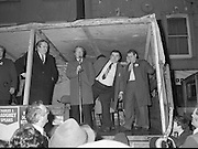 Image of Fianna Fáil leader Charles Haughey touring West Cork during his 1982 election campaign...04/02/1982.02/04/82.4th February 1982..Sheltered:..Charles Haughey takes shelter as he continues to appeal to the electorate.