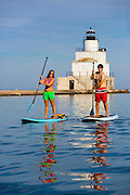Stand up paddle boarding in Manitowoc, Wisconsin.  Photo by Mike Roemer