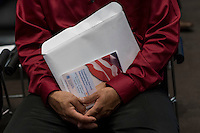 A U.S. citizen applicant holds paper work during a naturalization ceremony at the Evo A. DeConcini U.S. Courthouse in Tucson, Arizona, U.S., on Friday, Sept. 16, 2016. Photographer: David Paul Morris/Bloomberg