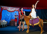 """Sara Greene and Gigi Greene with """"Zeus"""" performing in the center ring of the Granite State Circus at Weirs Beach.  (Karen Bobotas/for the Laconia Daily Sun)"""