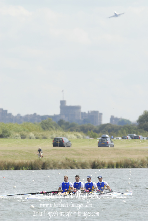 Eton, GREAT BRITAIN,    M4X Quadruple scull paddling on the course with Windsor Castle in view and aircraft leaving london Hearthrow Airport.. at the 2006 World Rowing Championships, 25/08/2006.  Photo  Peter Spurrier, © Intersport Images,  Tel +44 [0] 7973 819 551,  email images@intersport-images.com Rowing Course, Dorney Lake .  Adaptive, Rowing.