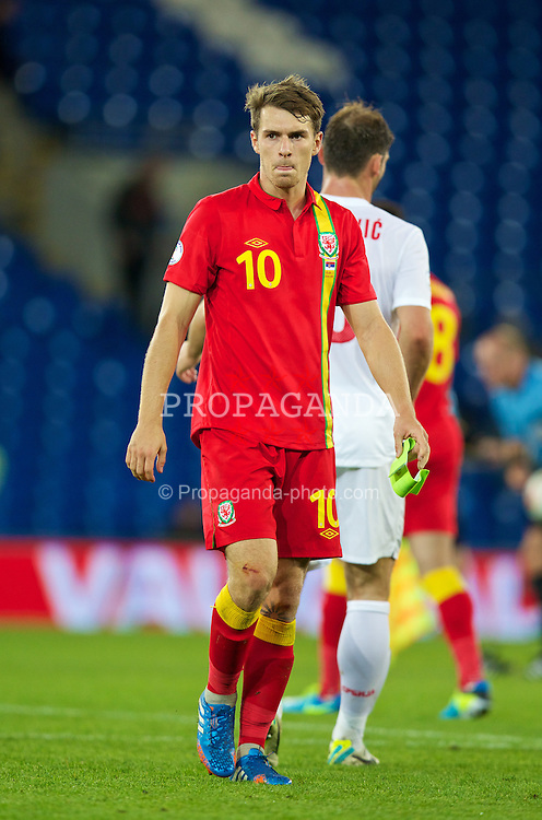 CARDIFF, WALES - Tuesday, September 10, 2013: Wales' Aaron Ramsey looks dejected after his side's 3-0 defeat by Serbia during the 2014 FIFA World Cup Brazil Qualifying Group A match at the Cardiff CIty Stadium. (Pic by David Rawcliffe/Propaganda)