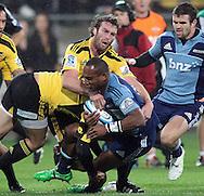 Hurricanes Jason Eaton tackles Josevata Rokokoko. Super Rugby - Hurricanes v Blues at Westpac Stadium, Wellington, New Zealand on Friday 6th May 2011. PHOTO: Grant Down / photosport.co.nz