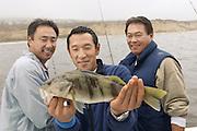 Sport Fisherman Displaying Fish