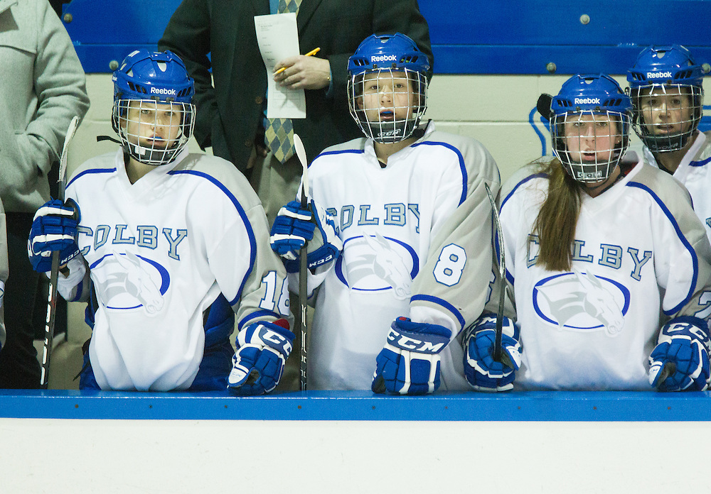 Maddy Borek, Maddie Dewhirst, Megan Fortier, and Breanna Davis of Colby College, on the bench during a NCAA Division III college hockey game against Trinity College at Alfond Rink at Alfond Arena, Friday Jan. 25, 2013 in Waterville, ME. (Dustin Satloff/Colby College Athletics)