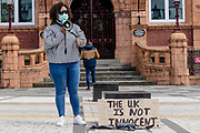 Emotional speaker addresses the valley town of Merthyr talking about her racial abuse when she was younger during the Black Lives Matter Protest in Merthyr Tydfil, Wales on 7 June 2020.