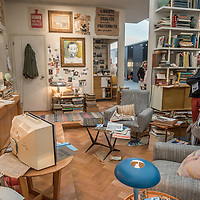 London, UK - 15 October 2014: people  look at the installation of an imaginary collector's apartment in Paris in 1968 curated by Helly Nahmad during the first day of Frieze Art Fair and Frieze Masters in Regent's Park.