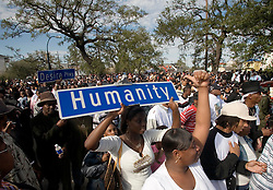 15 Jan, 2006. New Orleans, Louisiana. Post Katrina.<br /> A coalition of 27 social aid and pleasure clubs join forces for a second line parade with the Rebirth Brass band reclaiming the streets of New Orleans.  Plundered street signs held aloft in the crowd.<br /> Photo; Charlie Varley/varleypix.com