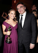 HOLLYWOOD, CA - FEBRUARY 27:  Academy Award winning actress Natalie Portman holds her Oscar for Best Actress in Black Swan and Danny Boyle attend the Fox Searchlight Oscar Party at My House on February 27, 2011 in Hollywood, California.  (Photo by Todd Williamson/WireImage)