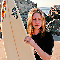 Kris Kunz holds her passion for surfing on the Pacific Coast Highway in Malibu, California.