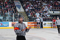 KELOWNA, CANADA - APRIL 25: Pat Smith, referee, speaks to the # of the Kelowna Rockets' bench on April 25, 2014 during Game 5 of the third round of WHL Playoffs at Prospera Place in Kelowna, British Columbia, Canada. The Portland Winterhawks won 7 - 3 and took the Western Conference Championship for the fourth year in a row earning them a place in the WHL final.  (Photo by Marissa Baecker/Getty Images)  *** Local Caption *** Pat Smith; referee;