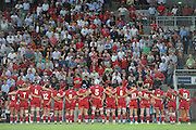 The crowd stands to salute ANZAC soldiers prior to kickoff during action from Round 11 of the Super 14 Rugby Union match between the Queensland Reds and the South African Stormers played at Suncorp Stadium on Friday 23 April 2010 ~ ©Image Aura Images.com.au ~ Conditions of Use: This image is intended for Editorial use as news and commentry in print, electronic and online media ~ For any alternative use please contact AURA Images.com.au