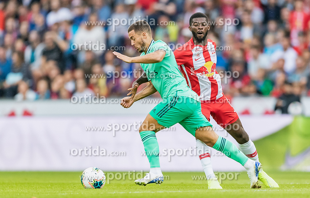 07.08.2019, Red Bull Arena, Salzburg, AUT, Testspiel, FC Red Bull Salzburg vs Real Madrid, im Bild v.l.: Eden Hazard (Real Madrid), Jerome Onguene (FC Red Bull Salzburg) // during a Friendly Match between FC Red Bull Salzburg and Real Madrid at the Red Bull Arena in Salzburg, Austria on 2019/08/07. EXPA Pictures © 2019, PhotoCredit: EXPA/ JFK