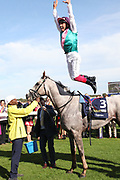 FRANKIE DETTORI celebrates with a Flying Dismount after winning The Group 1 William Hill St Leger Stakes over 1m 6f (£700,000) on LOGICIAN during the fourth and final day of the St Leger Festival at Doncaster Racecourse, Doncaster, United Kingdom on 14 September 2019.