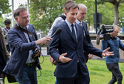 © Licensed to London News Pictures. 15/06/2019. London, UK. Conservative Party leadership candidate Jeremy Hunt is questioned by reporters as he arrives at a hustings event in central London. The remaining candidates in the leadership race will face a second round of votes in Parliament on Tuesday next week. Photo credit: Peter Macdiarmid/LNP