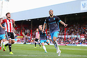 Sheffield Wednesday Forward Atdhe Nuhiu celebrates his penalty goal during the Sky Bet Championship match between Brentford and Sheffield Wednesday at Griffin Park, London, England on 26 September 2015. Photo by Phil Duncan.