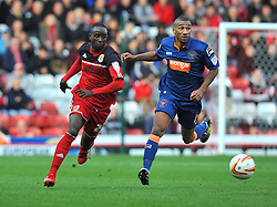 Bristol City's Albert Adomah takes the ball past Blackpool's Elliot Grandin - Photo mandatory by-line: Joe Meredith/JMP  - Tel: Mobile:07966 386802 17/11/2012 - Bristol City v Blackpool - SPORT - FOOTBALL - Championship -  Bristol  - Ashton Gate Stadium -
