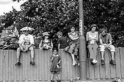 Group sitting near lamppost, Reclaim the Streets, Shepherd's Bush, London, July 1996