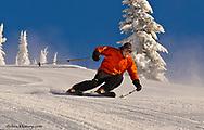 Brendan Friel carves on corduroy groomed runs at Whitefish Mountain Resort in Montana model released