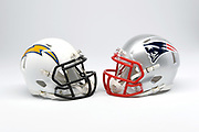 Detailed view of Los Angeles Chargers and New England Patriots helmets.