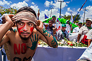 10 SEPTEMBER 2003 - CANCUN, QUINTANA ROO, MEXICO: A Mexican protester leads a march against the WTO during the WTO ministerial meetings in Cancun. Tens of thousands of protesters, mostly farmers, came to Cancun for the fifth ministerial of the World Trade Organization (WTO). They were protesting against developed nations pushing to get access to agricultural markets in developing nations. The talks ultimately collapsed after no progress with no agreements reached between the participants.           PHOTO BY JACK KURTZ