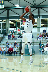 17 November 2017:  Jaylen Beasley for three during an College men's division 3 CCIW basketball game between the Alma Scots and the Illinois Wesleyan Titans in Shirk Center, Bloomington IL