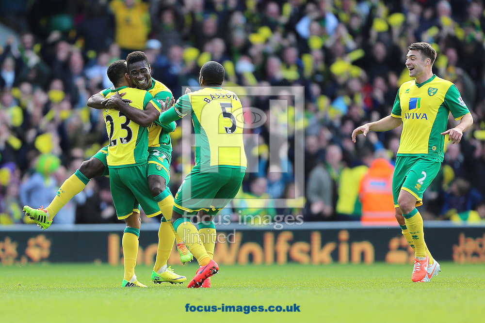 Alexander Tettey of Norwich City is congratulated by team mates after scoring the second goal of the Barclays Premier League match against Sunderland at Carrow Road, Norwich<br /> Picture by Richard Calver/Focus Images Ltd +447792 981244<br /> 22/03/2014