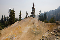 Steam rises from a mound at Sulphur Works, a hydrothermal area in Lassen Volcanic National Park, California, USA.